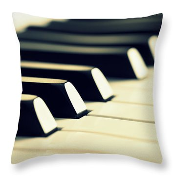 Keyboard Of A Piano Throw Pillow by Chevy Fleet