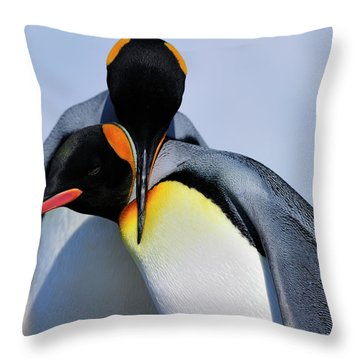 King Penguins Bonding Throw Pillow by Tony Beck