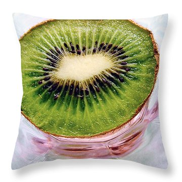 Throw Pillow featuring the photograph Kiwi Fruit On A Pink And Blue Glass Plate by Louise Kumpf