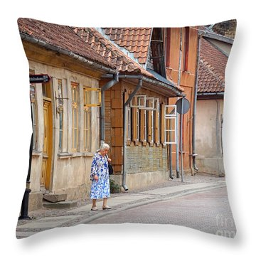 Kuldiga Street Crossing Throw Pillow by Martin Konopacki