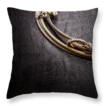 Lasso On Leather Throw Pillow by Olivier Le Queinec