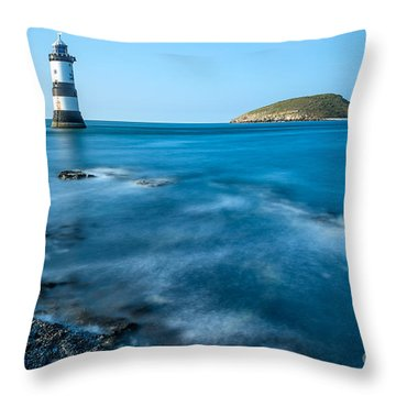 Lighthouse At Penmon Point Throw Pillow by Adrian Evans