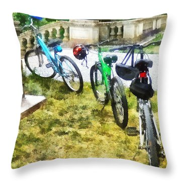 Line Of Bicycles In Park Throw Pillow by Susan Savad