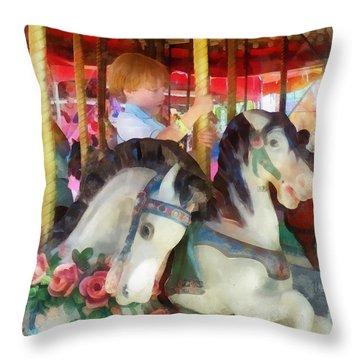 Little Boy On Carousel Throw Pillow by Susan Savad