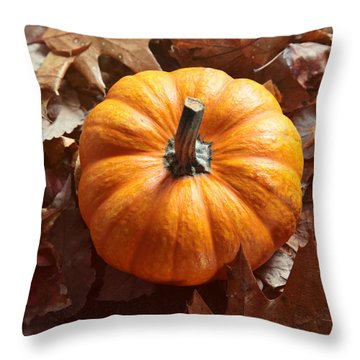 Throw Pillow featuring the photograph Little Pumpkin In A Bunch Of Leaves by Sandra Cunningham