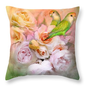 Throw Pillow featuring the mixed media Love Among The Roses by Carol Cavalaris