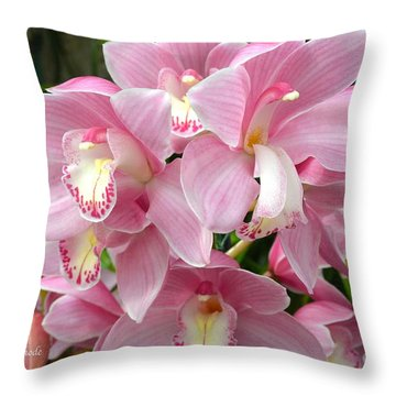 Throw Pillow featuring the photograph Cymbidium Pink Orchids by Jeannie Rhode