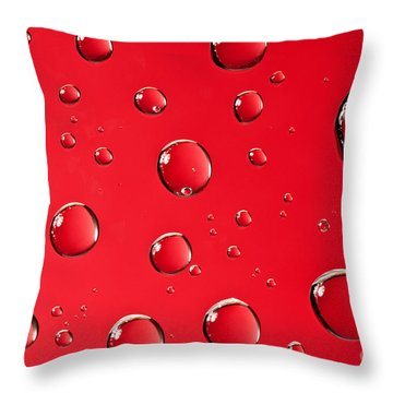 Macro Water Drop On Red Throw Pillow by Sharon Dominick