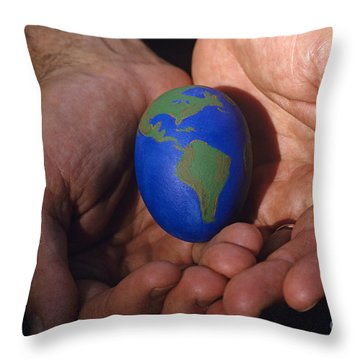 Man Holding Earth Egg Throw Pillow by Jim Corwin