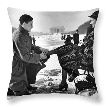 Man Lends A Helping Hand To Put On Skates Throw Pillow by Underwood Archives