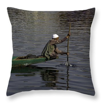 Man Plying A Wooden Boat On The Dal Lake Throw Pillow by Ashish Agarwal