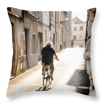 Man Riding Bicycle In Street In Puerto Pollenca Throw Pillow