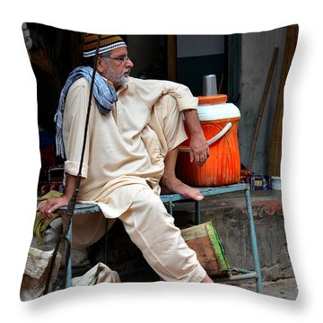 Man Sits And Relaxes In Lahore Walled City Pakistan Throw Pillow by Imran Ahmed