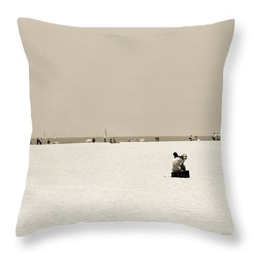 Man Sitting On A Beach Playing His Horn Throw Pillow by Stephen Spiller