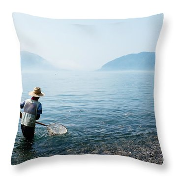 Man With A Net Throw Pillow
