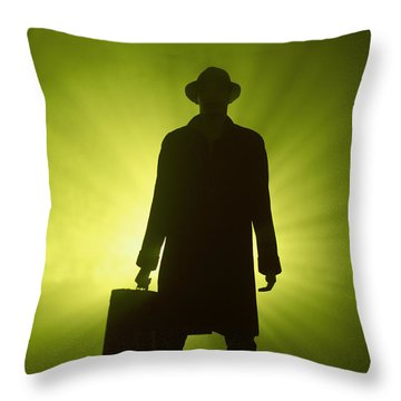 Throw Pillow featuring the photograph Man With Case In Green Light by Lee Avison
