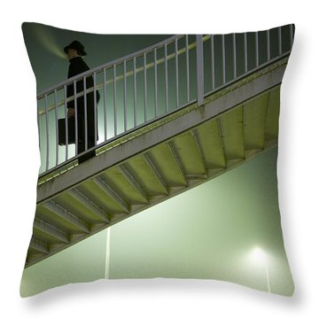 Throw Pillow featuring the photograph Man With Case On Steps Nighttime by Lee Avison