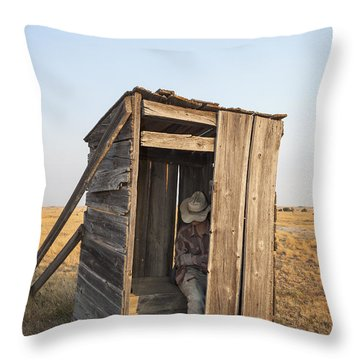 Throw Pillow featuring the photograph Mannequin Sitting In Old Wooden Outhouse by Bryan Mullennix