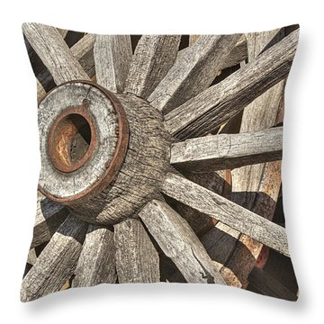 Many Wooden Wheels Throw Pillow by Phyllis Denton