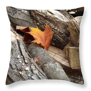 Throw Pillow featuring the photograph Maple Leaf In Wood Pile by Brenda Brown