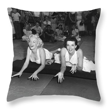 Marilyn Monroe And Jane Russell Throw Pillow by Underwood Archives