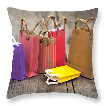 Miniature Shopping Bags Throw Pillow by Aged Pixel