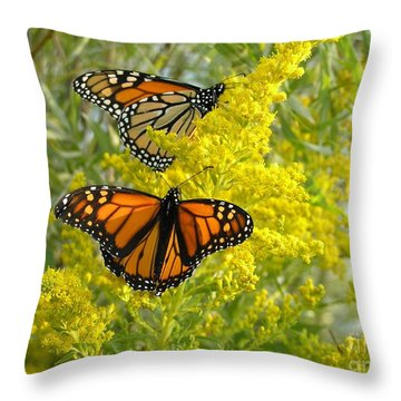 Monarchs On Goldenrod Throw Pillow by Susan  Dimitrakopoulos