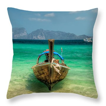 Moored Longboat Throw Pillow by Adrian Evans
