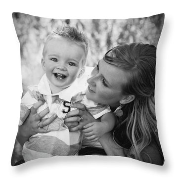 Mother And Son Laughing Together Throw Pillow by Daniel Sicolo