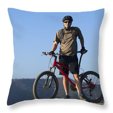 Mountain Biker Throw Pillow by Mike Raabe