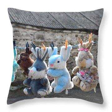 Toys On Washing Line Throw Pillow by Nina Ficur Feenan