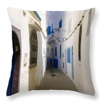 Throw Pillow featuring the photograph Narrow Backstreet In The Medina Of Asilah On Northwest Tip Of Atlantic Coast Of Morocco by Ralph A  Ledergerber-Photography
