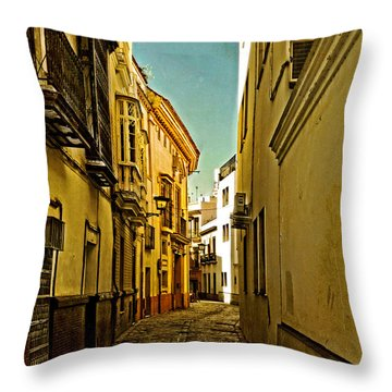 Narrow Street In Seville Throw Pillow by Mary Machare