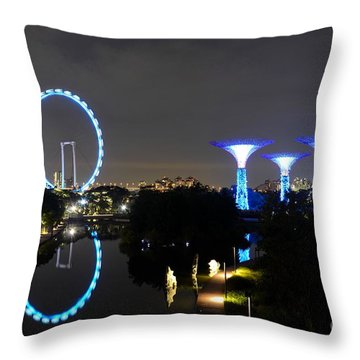 Night Shot Of Singapore Flyer Gardens By The Bay And Water Reflections Throw Pillow by Imran Ahmed