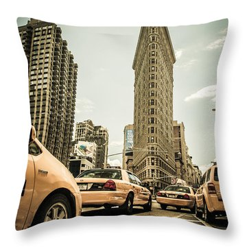 Nyc Yellow Cabs At The Flat Iron Building - V1 Throw Pillow by Hannes Cmarits