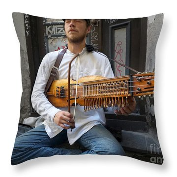 Nyckelharpa Player Of Estonia Throw Pillow by Martin Konopacki