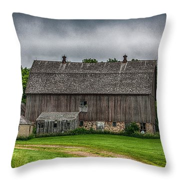 Old Barn On A Stormy Day Throw Pillow by Paul Freidlund