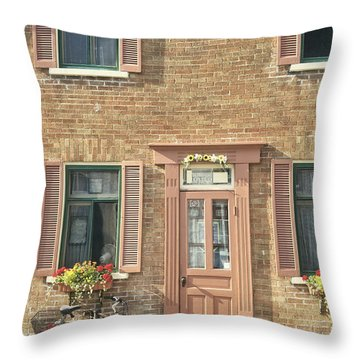 Old Downtown Building Doorway And Bike On Street Throw Pillow