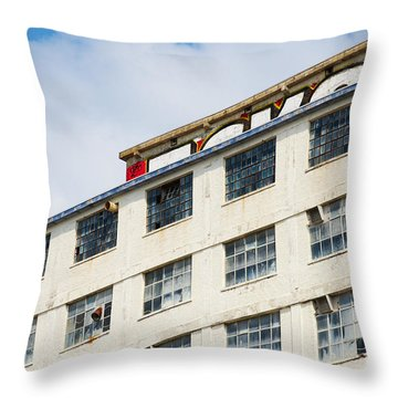 Throw Pillow featuring the photograph Old Factory Under A Clear Blue Sky by Nick  Biemans