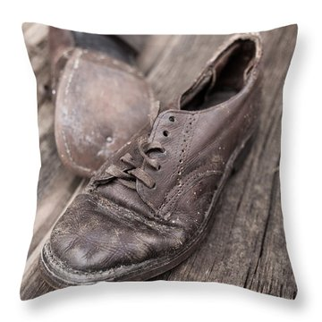 Old Leather Shoes On Wooden Floor Throw Pillow by Edward Fielding