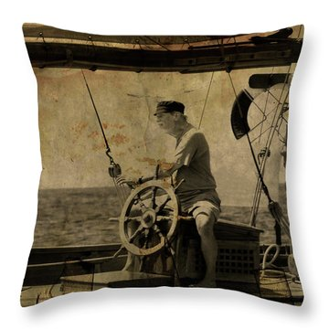 Throw Pillow featuring the photograph old sailor A vintage processed photo of a sailor sitted behind the rudder in Mediterranean sailing by Pedro Cardona