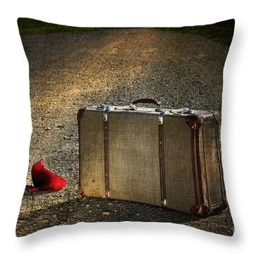 Old Suitcase With Red Shoes Left On Road Throw Pillow by Sandra Cunningham