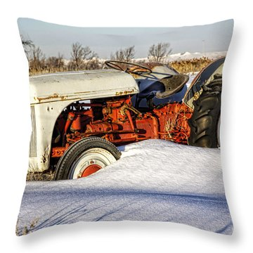 Old Tractor In The Snow Throw Pillow