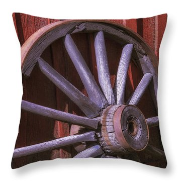 Old Wagon Wheel Leaning Against Barn Throw Pillow
