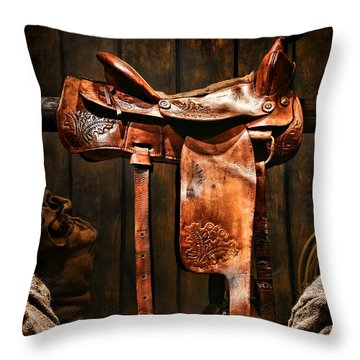 Old Western Saddle Throw Pillow by Olivier Le Queinec