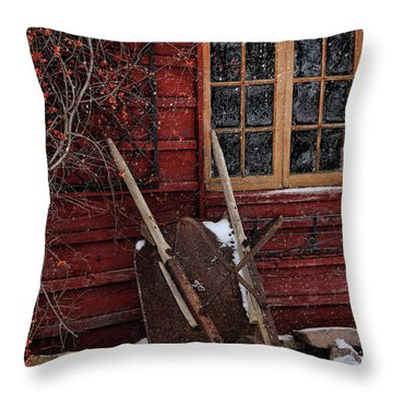 Old Wheelbarrow Leaning Against Barn In Winter Throw Pillow
