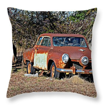 Throw Pillow featuring the photograph On Blocks by Linda Brown