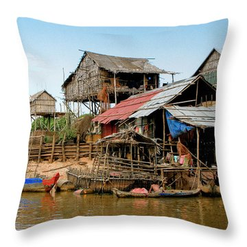 On The Shores Of Tonle Sap Throw Pillow by Douglas J Fisher