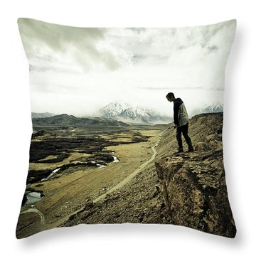 One Man Looks Down The Cliff Face Throw Pillow