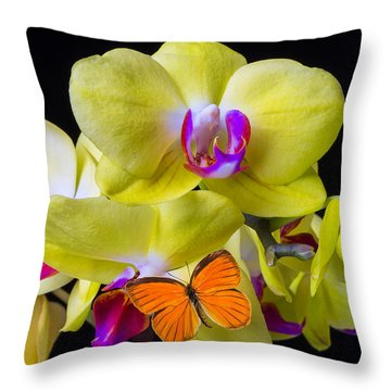 Orange Butterfly And Yellow Orchids Throw Pillow